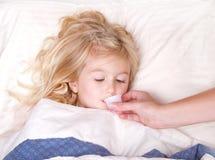 Sick preschoolerl taking medicine Royalty Free Stock Photo