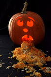 Sick Pumpkin. Carving with candle lighting insides Royalty Free Stock Image