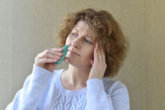 Sick with  rhinitis woman dripping nose medicine Royalty Free Stock Photography