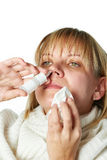 Sick with a rhinitis woman dripping nose medicine isolated Royalty Free Stock Photos