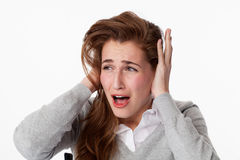 Sick 20s woman suffering from tinnitus, shouting for peace Stock Photo