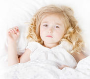 Sick or sad child in bed. Sick or Sad child preschool age in bed on white background Stock Photography