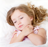 Sick or sad child in bed royalty free stock photos