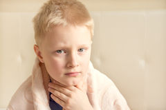 Sick and sad child. (boy, kid, teen) wrapped in blanket Stock Photography