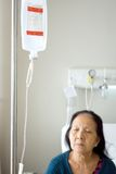 Sick senior infusion at hospital Stock Photo