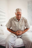 Sick senior man holding stomach Royalty Free Stock Photography
