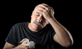 Sick senior man suffering with flu and a headache Stock Photo