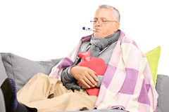 Sick senior measuring his body temperature Stock Photography