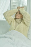 Sick senior woman   in bed Stock Images