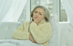 Sick senior woman   in bed Royalty Free Stock Photo