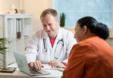 Sick senior woman having a doctor appointment Stock Photo