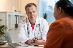Sick senior woman having a doctor appointment Stock Photography