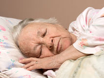 Sick senior woman. Lying at bed Royalty Free Stock Photo