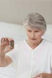 Sick senior woman taking her pills Royalty Free Stock Photo