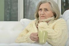 Sick senior woman  with  tea Stock Photo