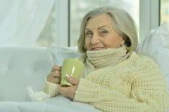 Sick senior woman  with  tea Royalty Free Stock Photos
