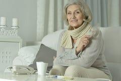 Sick senior woman  with  tea Royalty Free Stock Image