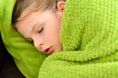 Sick sleeping child girl under a blanket Stock Photography
