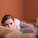 Sick on a sofa Royalty Free Stock Images