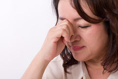 Sick, stressed woman suffering from headache Royalty Free Stock Photography