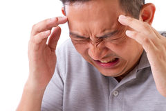 Sick, stressful man suffering from headache Stock Photos