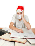 Sick Student in Santa Hat Royalty Free Stock Images