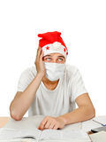 Sick Student in Santa Hat Royalty Free Stock Photos