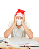 Sick Student in Santas Hat Royalty Free Stock Photos