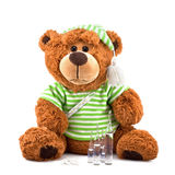 Sick teddy Bear. Isolated on white background Stock Photography