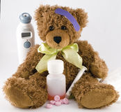 Sick teddy bear. With bandage on his head  and yellow bow Royalty Free Stock Photo