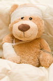 Sick teddy bear stock images