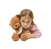 Sick teddy bear with a cute girle. Broken arm - isolated teddy bear with her little friend Royalty Free Stock Photos
