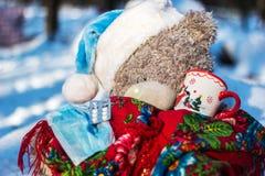 Sick teddy bear. In the wood stock photos
