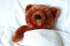 Sick teddy with injury in bed Royalty Free Stock Photo