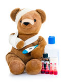 Sick teddy with medicine Royalty Free Stock Image