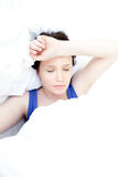 Sick teen girl lying in her bed. Portrait of a sick teen girl lying in her bed Stock Photo