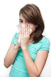 Sick teen girl using tissue on white background Stock Photo