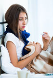 Sick teenage girl with hot tea and medication indoors Royalty Free Stock Image