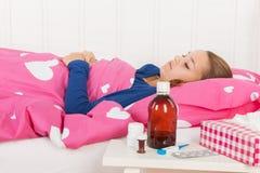 Sick teenager girl Stock Images