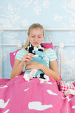 Sick teenager girl Stock Image