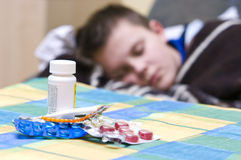Sick teenager and medicines Stock Photography