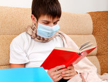 Sick Teenager read a Book Stock Photos