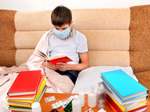 Sick Teenager read the Book Royalty Free Stock Photo