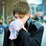 Sick Teenager on the Street Stock Photo