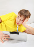 Sick Teenager with Tablet Computer Stock Photography