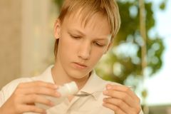 Sick teenager taking medication Royalty Free Stock Photo