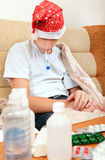 Sick Teenager with Thermometer Royalty Free Stock Image