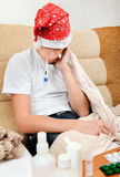 Sick Teenager with Thermometer Stock Images