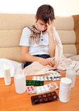Sick Teenager with Thermometer Royalty Free Stock Photography
