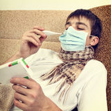 Sick Teenager with Thermometer Stock Photography